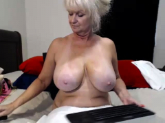 Big-boobed granny toying her pussy and asshole
