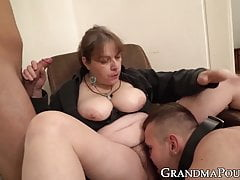Imperious granny submits two dicks to her rule