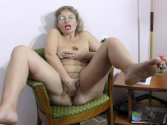 Grey-haired gilf Zosya from Russia finger fucks her pussy