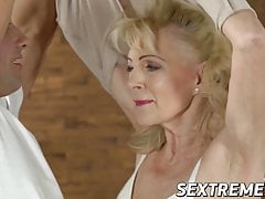 Promiscuous grannie sucks and fucks with younger stud