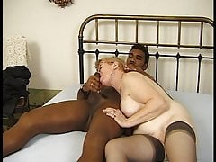 Giant senior doll takes a black cock