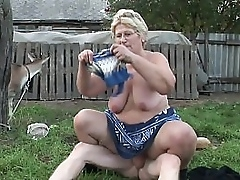 A granny has a craving be proper of young cock in her farm increased by she gives a good blowjob