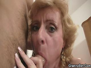 Peaches granny jumps on young cock