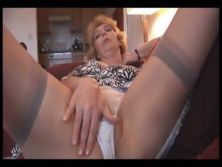 Charming mature milf with stockings strips plus shows off shaved pussy