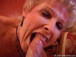 Pulchritudinous cougar sucks cock with an increment of eats cum