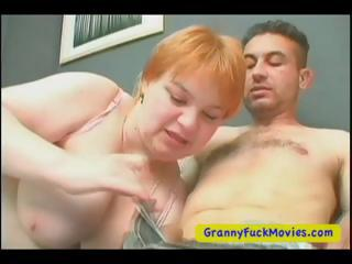 Broad in the beam and sex-crazed granny plays with young guy