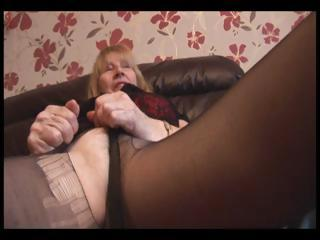 Puristic Granny in pantyhose striptease