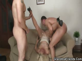 Two guys prick her aged holes