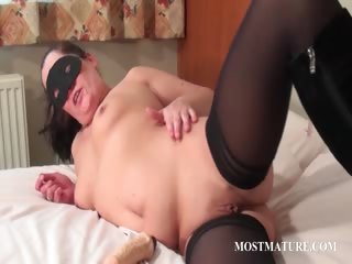 Mature in mask masturbating pussy