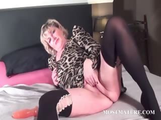 Blondie fucks her adult twat about dildo