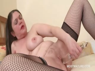 Mature slut gets orgasmic pleasures with dildo