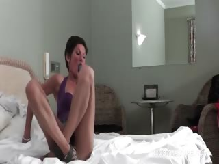 Brunette slim full-grown fucks vibrator upskirt close to bed