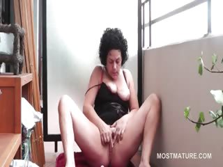Curly grown up brunette rubbing will not hear of down in the mouth pussy on the floor