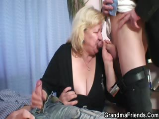 Big grandma takes two dicks