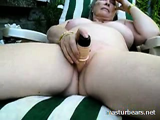 Granny Alice toying pussy forth the garden