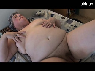 Fat granny masturbating about long black dildo