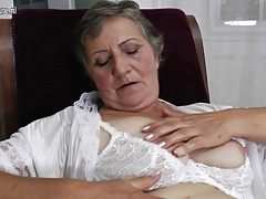 Fur covered granny still works her  pussy