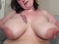 Massive breasted mature Plus-size toying with her
