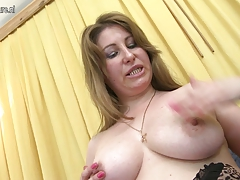 Horny MILF playing with her moist cunt