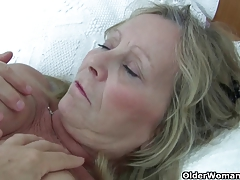 Granny with immense tits gets finger pounded by