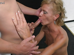 Mature mother sucking and boinking  young fellow