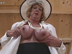 British granny toying with her milk cans and pussy