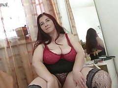 Big breasted mama playing with her tits and pussy