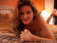 Kinky Mummy plays with her pussy and blows the cameraman