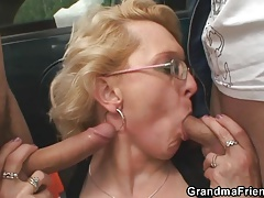 Grandma drinks two penises in the fields