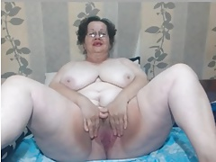 Toothless hairy granny with big globes teases on webcam