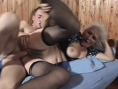 Slutty mature woman in black stockings gets pounded deep by a youthfull fellow