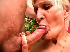 Horny blonde granny takes her dentures out and sucks a boner