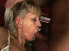 Light-haired granny sucks and drills a young cock