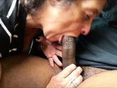 Super-naughty grandma blowing a black rod