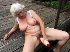 Stacked mature woman fucks a ample faux-cock and works her facehole on a stiffy