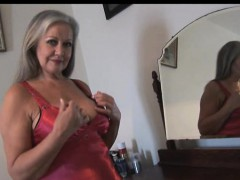 Attractive buxomy granny posing and teasing
