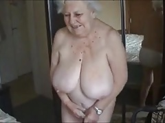 Aged nude grandma with meaty boobs