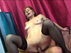 Huge-chested brunette granny riding long shaft on couch
