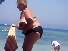 busty granny on the beach