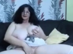 Hot busty granny showing her thick tits in front of cam