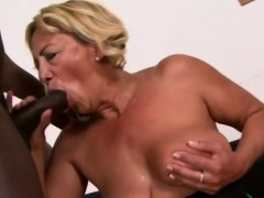 Immense boob GILF is toying with a huge black rod for fun