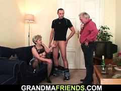 Old grandma takes two cocks from both sides