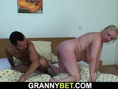 Huge-chested senior blonde granny is doggy-fucked